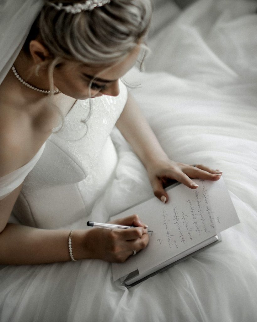 bride writing her own vows for unique wedding ceremony ideas.